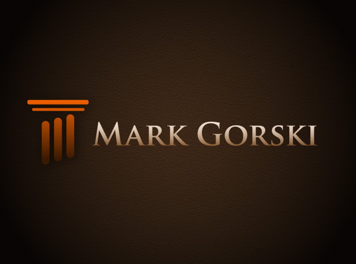 Logo created by Joel Mertz for Mark Gorski. The logo is an orange column made of three, vertical rounded rectangles and two narrow horizontal ones.
