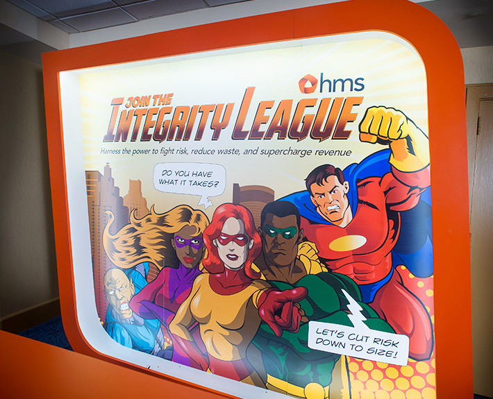 HMS's superhero themed booth skin exhibited at the National Other Party Liability Group. Designed by Joel Mertz using illustrations from Getty.